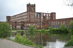 Following the Industrial Revolution, Heywood became a mill town, its landscape dominated by large brick-built cotton mills. This one is part of the Grade II listed Mutual Mills complex.