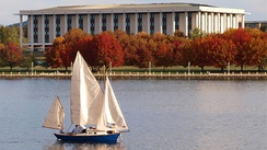 The library seen from Lake Burley Griffin in autumn.