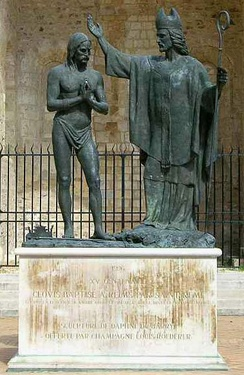 Statue in the Cathedral of Reims depicting the baptism of Clovis I by Saint Remi in around 496
