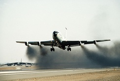 A KC-135A taking off with water injection to its J-57 engines