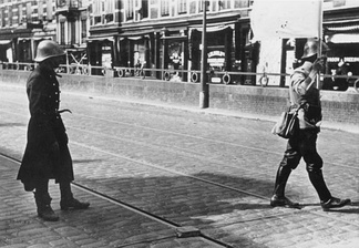 Dutch negotiator, carrying white flag, moves toward the German positions on the Noordereiland on 14 May 1940.