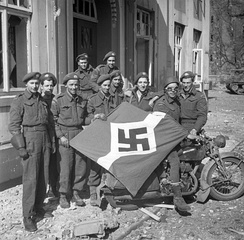 Lake Superior Regiment with captured Hitler Youth flag, Friesoythe, Germany, 16 April 1945