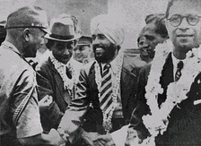 Major Iwaichi Fujiwara greets Mohan Singh, leader of the First Indian National Army. Circa April 1942.