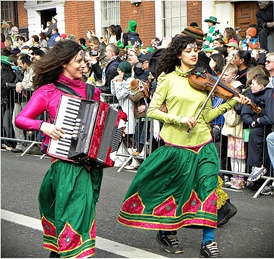 A girl playing an accordion on Saint Patrick's Day in Dublin, 2010