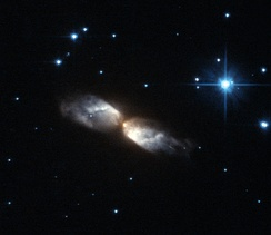 Protoplanetary nebula known as IRAS 20068+4051 taken by Hubble's Advanced Camera for Surveys.