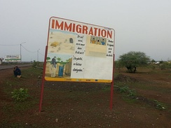 Sign Immigration near the border between Mali and Mauritania; sponsored by EU