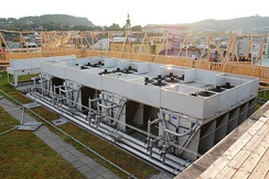 A central chilled water plant using air-cooled chillers, water-cooled chillers are cooled by a cooling tower