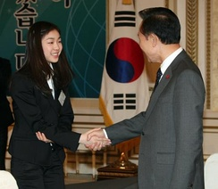 Kim with then South Korea president Lee Myung-bak at the Talent Award of Korea Ceremony, August 2010