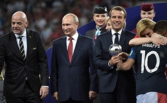 Kylian Mbappé receiving the World Cup best young player award from Emmanuel Macron