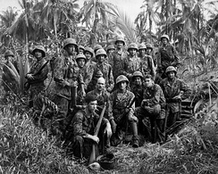 Marine Raiders gathered in front of a Japanese dugout on Bougainville.