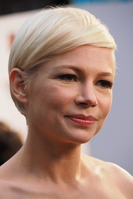 Face shot of Michelle Williams as she looks away from the camera