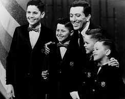The boys with Andy Williams in 1964. From left: Alan, Wayne, Williams, Merrill and Jay.