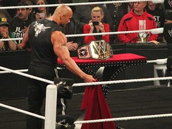 The Rock revealing the brand new WWE Championship design in 2013