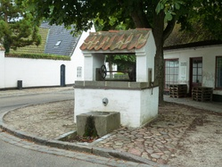 The old well next to the village pond. The current brick structure is from 1919