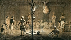 Dayak Festival in a traditional Longhouse, 1846, Dutch Borneo.