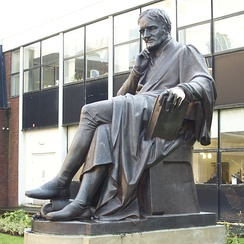 Statue of John Dalton by William Theed outside the university's building in Chester Street