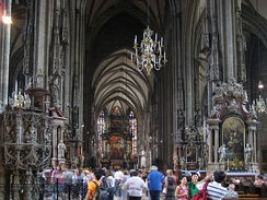 Cathedrals often contain a wealth of artworks. Tourists visiting the interior of St. Stephen's Cathedral, Vienna.