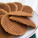 Stroopwafels (syrup waffles) are a treat consisting of waffles with caramel-like syrup filling in the middle.