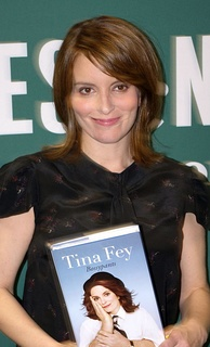 Fey holding a copy of Bossypants, published in April 2011