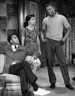 A scene from the play A Raisin in the Sun. From left: Louis Gossett Jr. as George Murchison, Ruby Dee as Ruth Younger and Poitier as Walter Younger.