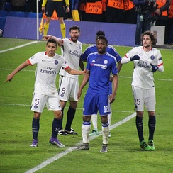 Marquinhos (in white, number 5) in a UEFA Champions League match against Chelsea in March 2016