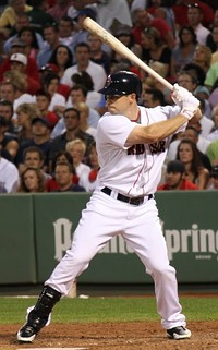 Daniel Nava wearing the current Red Sox home uniforms.