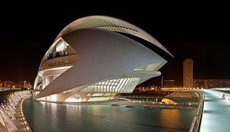 Palau de les Arts Reina Sofía in València, Spain, photographed at night with the city in the background