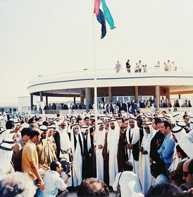 Historic photo depicting the first hoisting of the United Arab Emirates flag by the rulers of the emirates at The Union House, Dubai on 2 December 1971