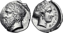 Above: Six rod-shaped obeloi (oboloi) displayed at the Numismatic Museum of Athens, discovered at Heraion of Argos. Below: grasp[n 2] of six oboloi forming one drachma