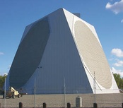 US Air Force PAVE PAWS phased array radar antenna for ballistic missile detection, Alaska.  The two circular arrays are each composed of 2677 crossed dipole antennas.