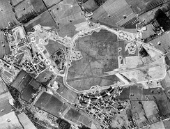 Aerial photography of RAF Honington, 25 January 1944 oriented north. The pre-World War II Honington Airfield is on the right, the 1st Strategic Air Depot is to the left. Note the large number of B-17 Flying Fortress aircraft parked on numerous hardstands at both the airfield and depot