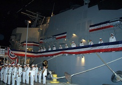 U.S. Navy sailors man the rails of the training simulator, USS Trayer (BST-21), which was completed in June 2007
