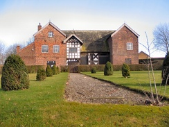 The 14th-century Baguley Hall, in Baguley is also a Grade I listed building