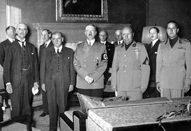 Interior photograph, showing in the foreground the five main signatories to the Munich Agreement, and in the background their various aides and assistants. Of the five, the two to the left are in black suits, the remainder in military uniform.