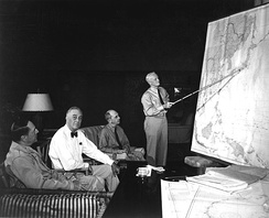 1944 Strategy Conference in Honolulu. Left to right: MacArthur, Roosevelt, Leahy, Nimitz.  The discussion weighs the options of Formosa or the Philippine Islands as the next operational target in the Pacific theater.