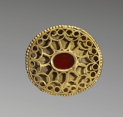 A Hunnish oval openwork fibula set with a carnelian and decorated with a geometric pattern of gold wire, 4th century, Walters Art Museum