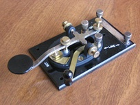 "A typical ""straight key"" model used for transmitting and transcribing Morse code"