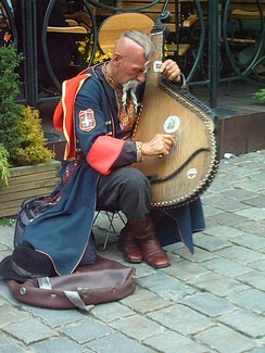 A Ukrainian Cossack (Ostap Kindrachuk) playing the bandura and wearing traditional clothing