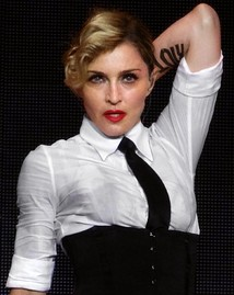 A blond woman wearing a white shirt and black necktie.