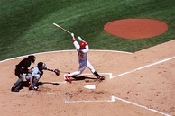 Mark McGwire hitting a home run at Busch Stadium.