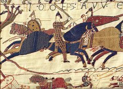 Depiction of Bishop Odo (wielding club at centre) who imprisoned Henry from 1088–89. From the Bayeux Tapestry.