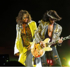 Steven Tyler (left) and Joe Perry (right) performing at the Nassau Coliseum on July 1, 2012