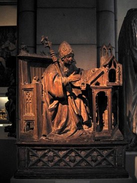 Saint Ambrose in His Study, c. 1500. Spanish, Palencia. Wood with traces of polychromy. Metropolitan Museum of Art, New York City.