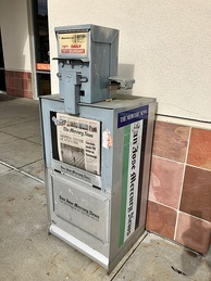 """The Mercury News"" stickers have been affixed to San Jose Mercury News vending machines."