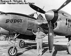 "Major Thomas McGuire next to his P-38 ""Pudgy (V)"" in 1944"