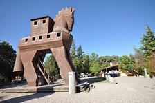 Wooden Trojan Horse monument in the plaza before the modern gate to the ancient city