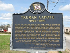 Historical marker at the site of the house Truman Capote frequently visited in Monroeville, Alabama.