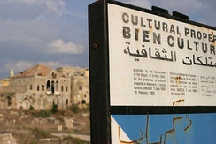 A large sign which marks the ancient city of Tyre as protected cultural property according to the 1954 Hague Convention for the Protection of Cultural Property in the Event of Armed Conflict.