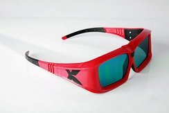 A pair of LC shutter glasses used to view XpanD 3D films. The thick frames conceal the electronics and batteries.