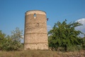 Watch tower of Vytautas the Great in Kherson with the historical state flag of Lithuania